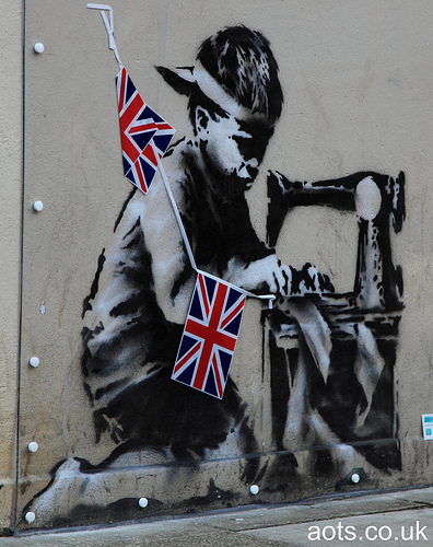 Banksy - child sewing bunting
